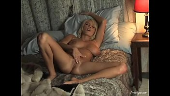 Busty blonde jerking off on her friend's porn movie