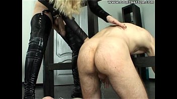 She fucks him with strap-on from behind. Femdom action at home.